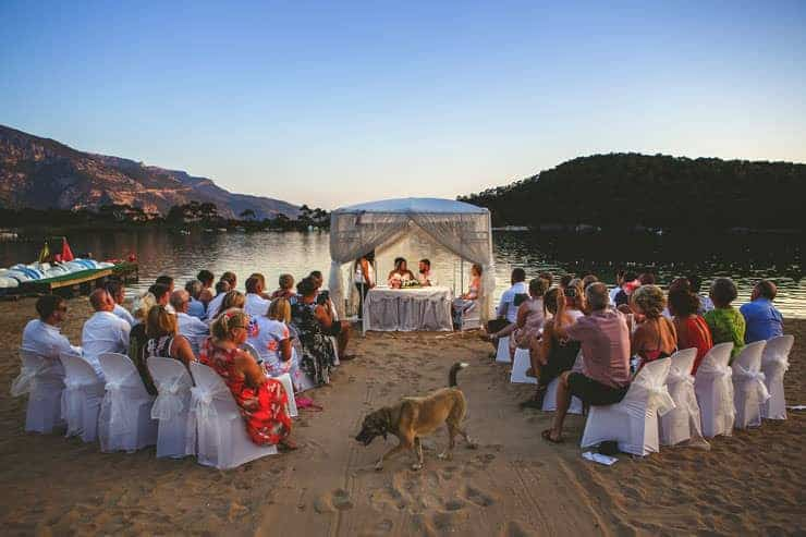 Oludeniz Billys Beach Wedding Photos - first kiss