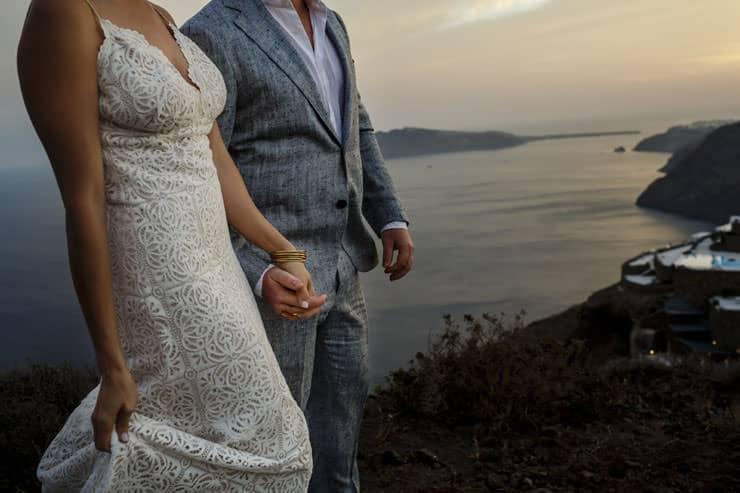 Santorini Wedding Photography - Kiss of Ceremony at sunset